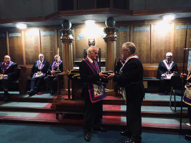 W.Bro. Norman Jones presenting an oak box containing three keystone inscribed mauls to V.W.Bro. David Alexander Wright